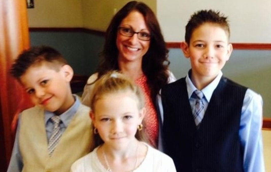 Karey Cooper with three children from her first case as a social worker.