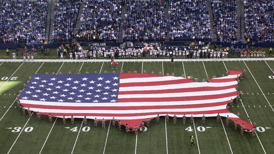 "FILE - In this Sunday, Nov. 8, 2009 file photo, a U.S. flag in the shape of the continental United States is displayed on the field of Lucas Oil Stadium before an NFL football game between the Indianapolis Colts and the Houston Texans in Indianapolis. Marc Leepson, author of ""Flag: An American Biography,"" agrees. ""We don't have a monarch or a state religion,"" he says. ""In some ways, the flag is a substitute."" (AP Photo/AJ Mast)"