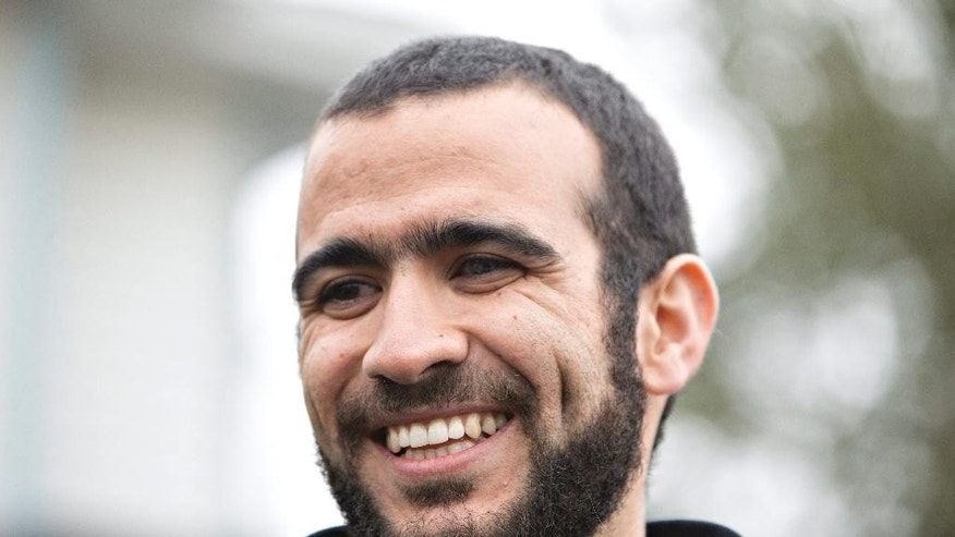 FILE - This May 7, 2015, file photo, shows former Guantanamo Bay prisoner Omar Khadr speaking to media outside his lawyer Dennis Edney's home in Edmonton, Alberta.  A federal judge in Utah has awarded a $134.2 million default judgment in a lawsuit filed on behalf of two American soldiers against Khadr, a Canadian man who pleaded guilty to committing war crimes when he was 15. (Jason Franson/The Canadian Press via AP, File) MANDATORY CREDIT