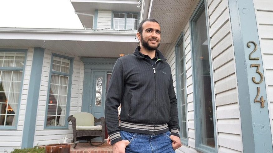 FILE - In this May 7, 2015, file photo, former Guantanamo Bay prisoner Omar Khadr exits the front door of his lawyer Dennis Edney's home to speak the media in Edmonton, Alberta, Thursday, May 7, 2015. A federal judge in Utah has awarded a $134.2 million default judgment in a lawsuit filed on behalf of two American soldiers against Khadr, a Canadian man who pleaded guilty to committing war crimes when he was 15. (Nathan Denette/The Canadian Press via AP, File) MANDATORY CREDIT