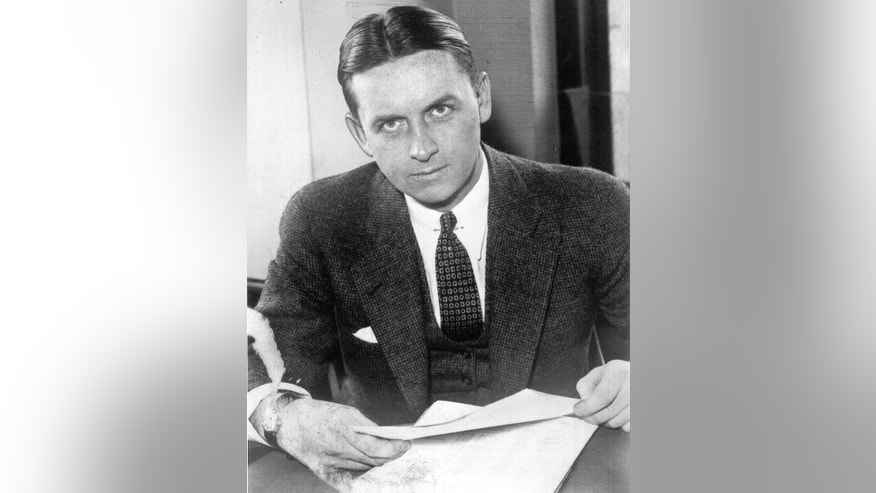 "FILE - This undated file photo provided by The Plain Dealer shows Eliot Ness in Cleveland. Ness, the famed Prohibition agent who led the ""Untouchables"" in their crusade against Chicago gangster Al Capone's liquor bootlegging rackets, later became the top executive at bank services company Diebold Inc. Part of his compensation appears to have been company stock that recently surfaced in Florida, sparking a new legal fight between the company and the Ness estate. (The Plain Dealer via AP, File)"