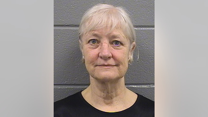 This undated booking photo provided by the Cook County Sheriff's Department shows 63-year-old Marilyn Hartman. Hartman was released from the Cook County Jail in Chicago on Thursday, July 2, 2015, and says she's through with her run of stowaway attempts. She was arrested April 24, for loitering in a restricted area at O'Hare International Airport in Chicago. She was charged with misdemeanor criminal trespassing on state land and released. She was arrested again in Chicago on Sunday May 3, at Midway International Airport and charged with the same offense in addition to violating her bail bond. Hartman has succeeded in getting on a flight at least once without a ticket. She has previously said she's mentally ill and homeless. (Cook County Sheriff's Department via AP)