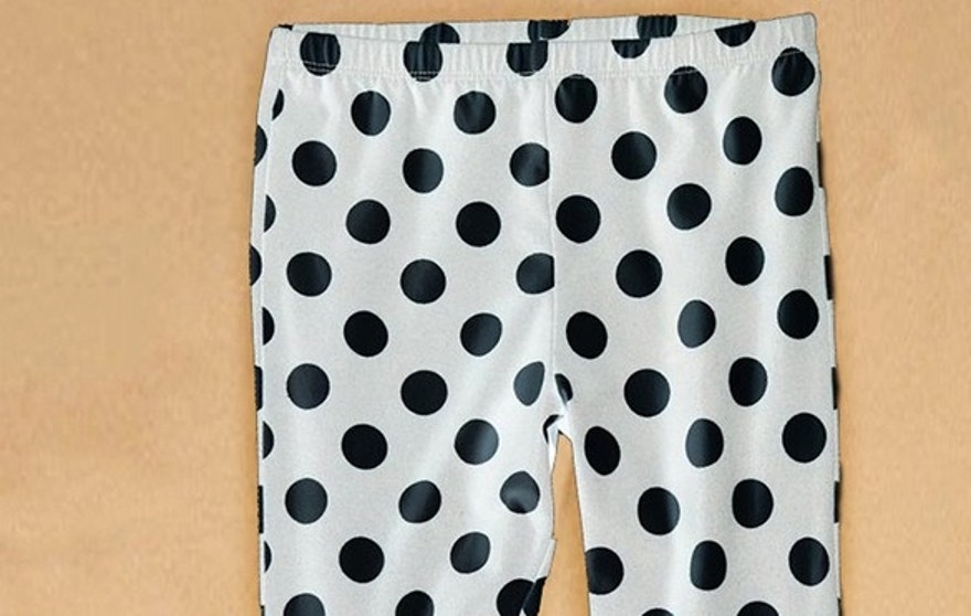 "This photograph shows leggings the child was wearing when she was found.  They are white with black polka dots about an inch in diameter, size 4T, manufactured by ""Circo."""