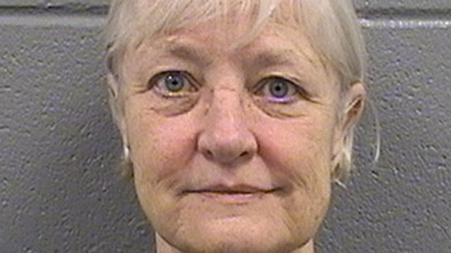 This undated booking photo provided by the Cook County Sheriff's Department shows 63-year-old Marilyn Hartman. Hartman was released from the Cook County Jail in Chicago on Thursday, July 2, 2015, and says shes through with her run of stowaway attempts.