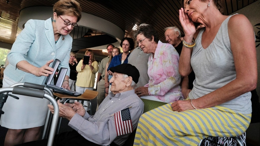 Horace Appleby, a 101-year-old veteran, is presented a Silver Star and Bronze Star by Rep. Marcy Kaptur last week as his family looks on.