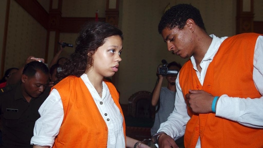 FILE - In this March 31, 2015 file photo, Heather Mack, 19, left, and her boyfriend Tommy Schaefer, 21, both from Chicago, are handcuffed as they arrive at a courtroom during their trial in Bali, Indonesia. Mack and Schaefer, 19, were both convicted in the killing of Mack's mother, Sheila von Wiese-Mack, whose body was found stuffed inside a suitcase in a taxi at a Bali resort last August. The Chicago Tribune reports Monday, July 6, 2015, that Indonesian court documents, recently made public in a Cook County court, reveal the details of the hours leading up to Wiese-Mack's killing. (AP Photo/Firdia Lisnawati, File)