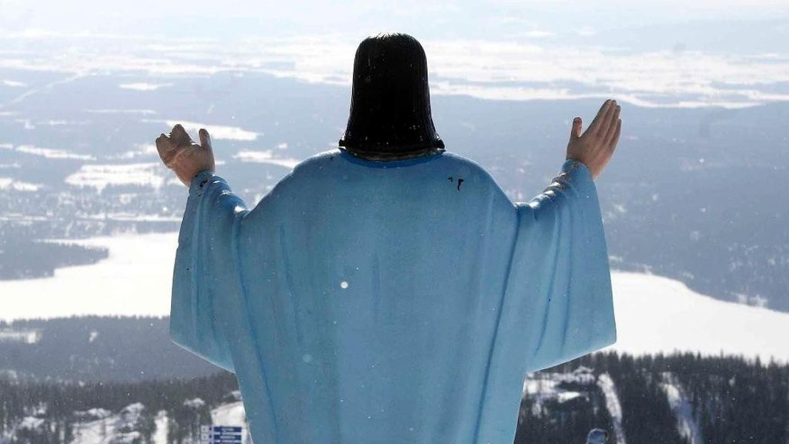 FILE - In this Feb. 20, 2011 file photo, the statue of Jesus Christ at Whitefish Mountain Resort overlooks Whitefish Lake and the Flathead Valley in Whitefish, Mont.  Federal appeals court justices in Portland, Ore., are hearing arguments from an atheist group that the six-foot-tall Jesus statue needs to come down because the ski resort is on U.S. Forest Service property, and the statue is therefore a violation of the constitutional principle separating church and state. (Linda Thompson/The Missoulian via AP, File)
