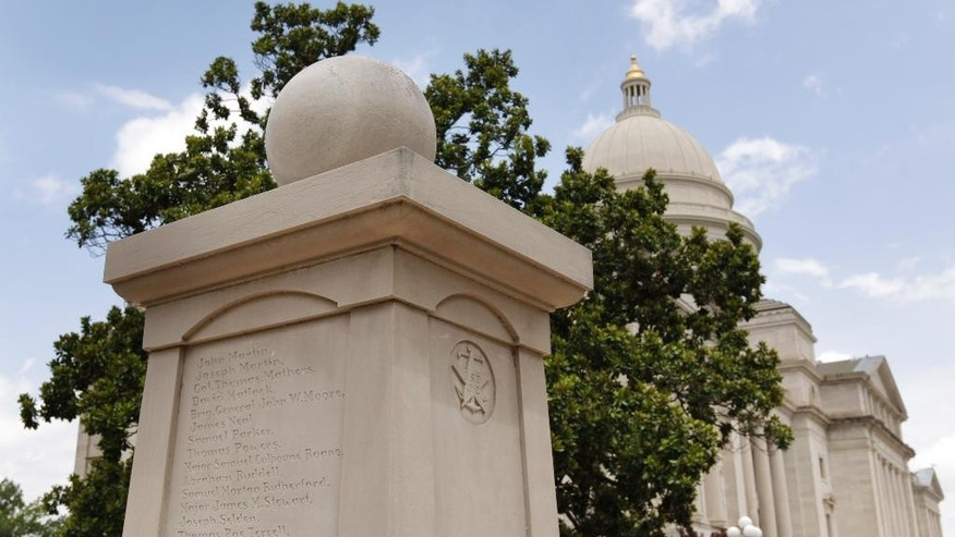 A memorial to War of 1812 soldiers buried in Arkansas stands on the grounds of the Arkansas state Capitol in Little Rock, Ark., Tuesday, July 7, 2015. Statues and memorials could be joined by a monument of a Hindu monkey-faced god turning the Arkansas Capitol into a menagerie following the Legislature's decision to allow a privately funded Ten Commandments display. (AP Photo/Danny Johnston)
