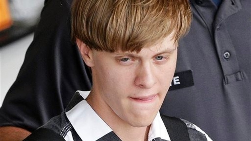 Charleston, S.C., shooting suspect Dylann Roof is escorted from the Cleveland County Courthouse in Shelby, N.C., Thursday, June 18, 2015. (AP Photo/Chuck Burton)