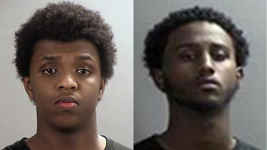 FILE - In this combination of 2015 file photos provided by the Sherburne County, Minnesota, Sheriff's Office are Zacharia Yusuf Abdurahman, left, and Hanad Mustafe Musse, right. The Minnesota men  are both charged with one count of conspiracy to provide material support to the Islamic State group and one count of attempting to provide such support.  (Sherburne County Sheriff's Office via AP)