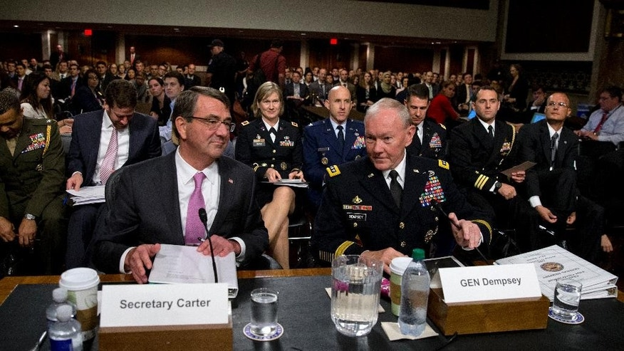 Chairman of the Joint Chiefs of Staff, Gen. Martin Dempsey and Defense Secretary Ash Carter take their seats as they arrive at the Senate Armed Services Committee hearing on Capitol Hill in Washington, Tuesday, July 7, about Counter-ISIL (Islamic State of Iraq and the Levant) Strategy. Carter and Dempsey face questions from members of the Senate panel about President Barack Obama's strategy to defeat Islamic State militants. (AP Photo/Carolyn Kaster)
