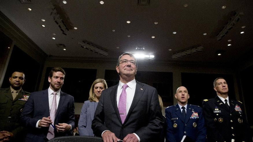 Defense Secretary Ash Carter stands by his seat as he arrives at the Senate Armed Services Committee hearing on Capitol Hill in Washington, Tuesday, July 7, about Counter-ISIL (Islamic State of Iraq and the Levant) Strategy. Carter and Chairman of the Joint Chiefs of Staff, Gen. Martin Dempsey face questions from members of the Senate panel about President Barack Obama's strategy to defeat Islamic State militants. (AP Photo/Carolyn Kaster)