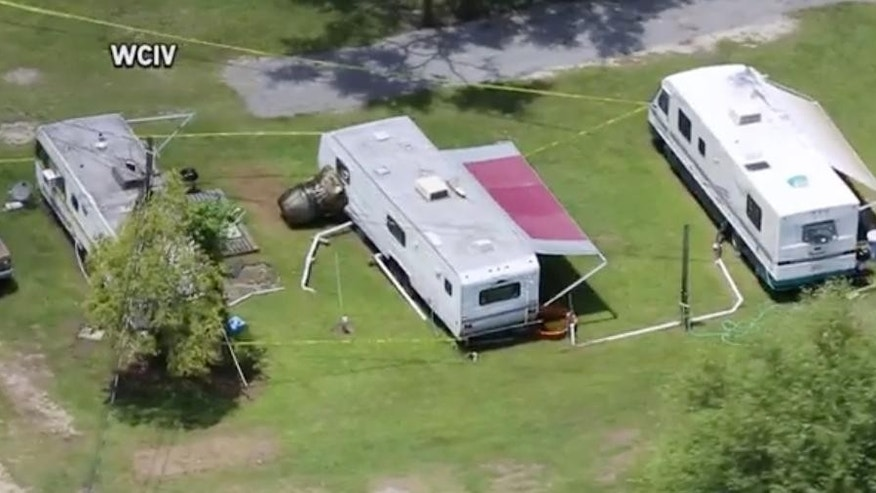 Debris from a F-16 fighter jet and plane collision scatter the ground near Moncks Corner, S.C., Tuesday, July 7, 2015. People aboard the smaller Cessna were killed, and the plane was completely destroyed, National Transportation Safety Board spokesman Peter Knudson said. (WCIV-TV via AP) MANDATORY CREDIT; LOCAL TV OUT