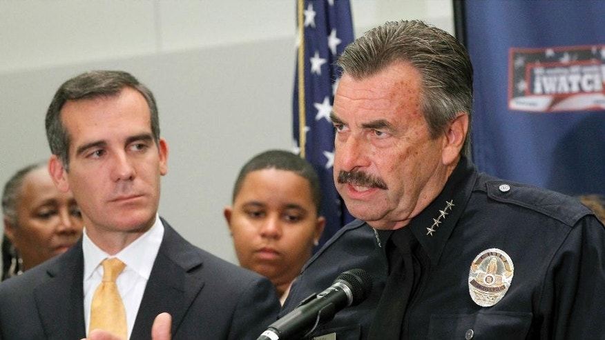 "Los Angeles Police Chief Charlie Beck speaks as Los Angeles Mayor Eric Garcetti listens at left at a news conference to discuss mid year crime statistics in Los Angeles Wednesday, July 8, 2015. Crime has increased 13 percent in Los Angeles in the first six months of the year, ending more than a decade of declines in the nation's second-largest city, according to statistics released by the LAPD. Garcetti said ""this is bad news"" but that Los Angeles remains one of the safest large cities in the U.S. Beck partially attributed the crime spike to increases in homelessness, gang crime and domestic violence.  (AP Photo/Nick Ut)"