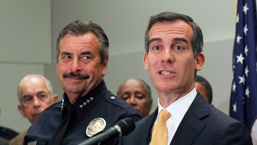 "Los Angeles Mayor Eric Garcetti, right, speaks as Police Chief Charlie Beck listens at left at a news conference to discuss mid year crime statistics in Los Angeles Wednesday, July 8, 2015. Crime has increased 13 percent in Los Angeles in the first six months of the year, ending more than a decade of declines in the nation's second-largest city, according to statistics released by the Los Angeles Police Department on Wednesday. Garcetti said ""this is bad news"" but that Los Angeles remains one of the safest large cities in the U.S. Beck partially attributed the crime spike to increases in homelessness, gang crime and domestic violence.(AP Photo/Nick Ut)"