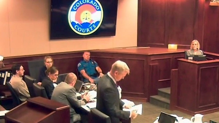 July 6, 2015: In this image taken from video, accused Colorado theater shooter James Holmes, second from left, listens to testimony by Dr. Raquel Gur, right, during his trial, in Centennial, Colo.