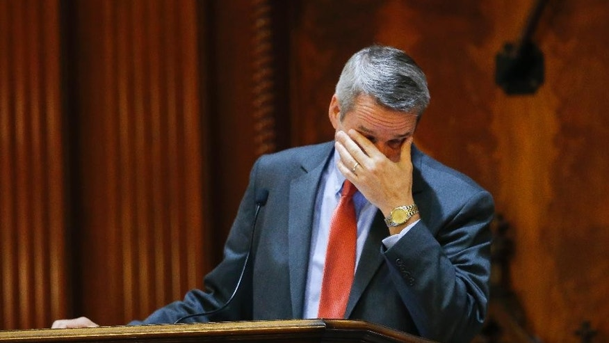Rep. Tommy Pope, R-York, rubs his eyes as the House debates a Senate bill calling for the Confederate flag to be removed from the Capitol grounds Wednesday, July 8, 2015, in Columbia, S.C. The House is under pressure to act after the state Senate passed its own measure, which is supported by Gov. Nikki Haley. But some Republicans proposed changes to the Senate bill that would preserve some kind of symbol in front of the Statehouse to honor their Southern ancestors. (AP Photo/John Bazemore)