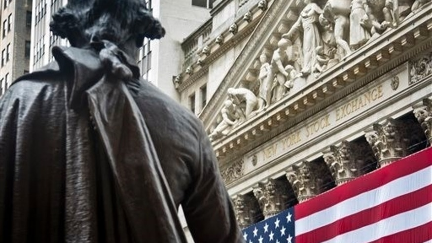 Federal Hall's George Washington statue stands near the flag-covered pillars of the New York Stock Exchange, Wednesday, July 8, 2015, in New York.  The New York Stock Exchange halted trading late Wednesday morning because of technical trouble. NYSE resumed trading later in the day. (AP Photo/Bebeto Matthews)