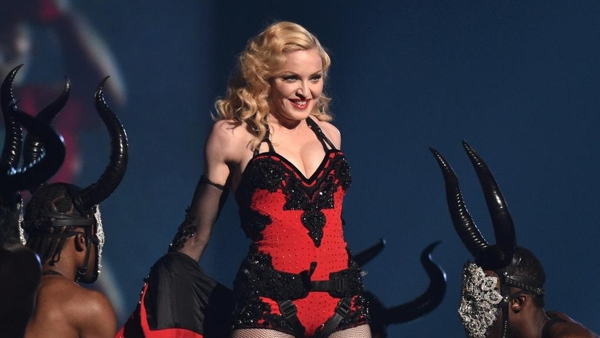 FILE - This Feb. 8, 2015 file photo shows Madonna performing at the 57th annual Grammy Awards in Los Angeles. Adi Lederman was sentenced Thursday to 14 months in prison after he was convicted of stealing and selling unreleased songs by. (Photo by John Shearer/Invision/AP, File)