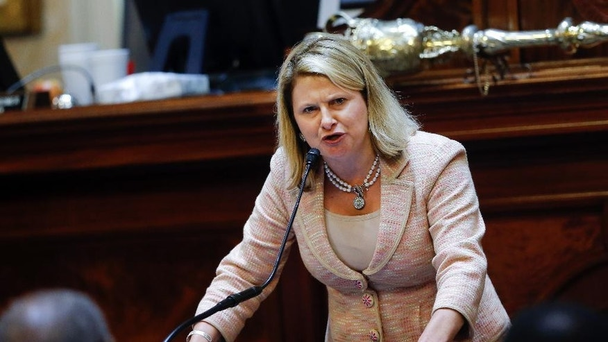 Rep. Jenny Horne, R-Summerville, gets emotional as she speaks during debate over a Senate bill calling for the Confederate flag to be removed from the Capitol grounds Wednesday, July 8, 2015, in Columbia, S.C. The House is under pressure to act after the state Senate passed its own measure, which is supported by Gov. Nikki Haley. But some Republicans proposed changes to the Senate bill that would preserve some kind of symbol in front of the Statehouse to honor their Southern ancestors. (AP Photo/John Bazemore)