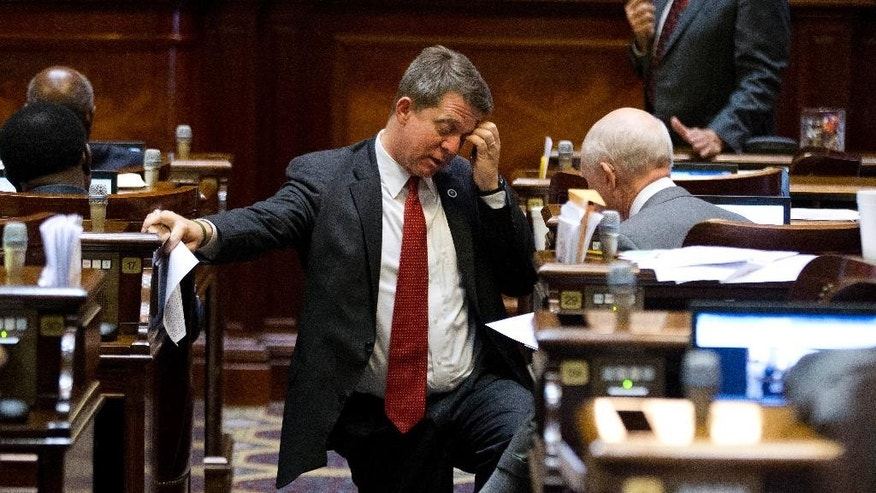Rep. James Smith, D-Columbia, speakers to another member on the floor of the House as a Senate bill calling for the Confederate flag to be removed from the Capitol grounds is debated Wednesday, July 8, 2015, in Columbia, S.C. (AP Photo/John Bazemore)
