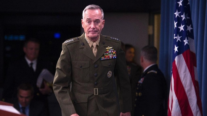 FILE - In this July 1, 2015, photo, Marine Corps Commandant Gen. Joseph Dunford walks onstage for a news media at the Pentagon, Wednesday, July 1, 2015. Dunford has been nominated to be the next Chairman of the Joint Chiefs of Staff and says the U.S. and its coalition partners are making moderate progress in the fight against the Islamic State but that the strategy should be re-evaluated if efforts to improve governance and build reliable local ground forces stall. (AP Photo/Cliff Owen, File)