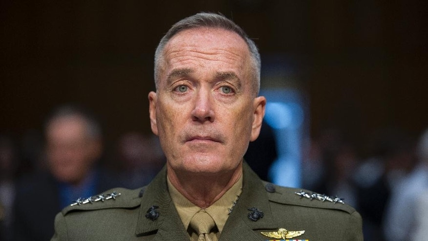 Marine Corps Commandant Gen. Joseph Dunford, Jr., testifies during his Senate Armed Services Committee confirmation hearing to become the Chairman of the Joint Chiefs of Staff, on Capitol Hill in Washington, Thursday, July 9, 2015.  Dunford says the U.S. and its coalition partners are making moderate progress in the fight against the Islamic State extremist group but that the strategy should be re-evaluated if efforts to improve governance and build reliable local ground forces stall.  (AP Photo/Cliff Owen)