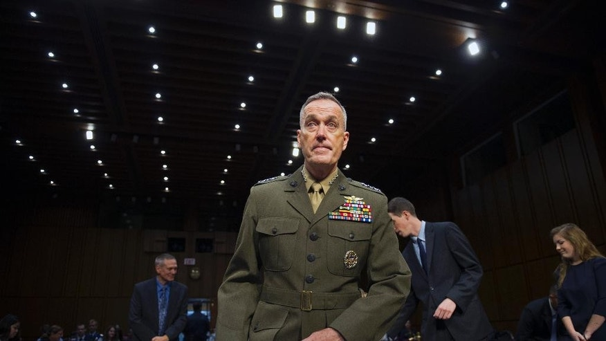 Marine Corps Commandant Gen. Joseph Dunford, Jr., takes a seat at the witness table to testify during his Senate Armed Services Committee confirmation hearing to become the Chairman of the Joint Chiefs of Staff, on Capitol Hill in Washington, Thursday, July 9, 2015. (AP Photo/Cliff Owen)