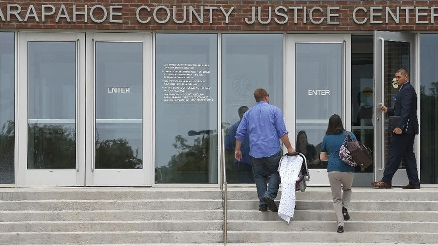 A man holds open the door of the Arapahoe County District Court, where the trial of Aurora movie theater shooter, James Holmes, continues, Wednesday, July 8, 2015, in Centennial, Colo. Prosecutors are tearing into the testimony of a second defense expert who concluded the shooter was so mentally ill that he couldn't tell right from wrong when killed 12 people and injured 70 during a packed midnight movie premiere three years ago. (AP Photo/Brennan Linsley)