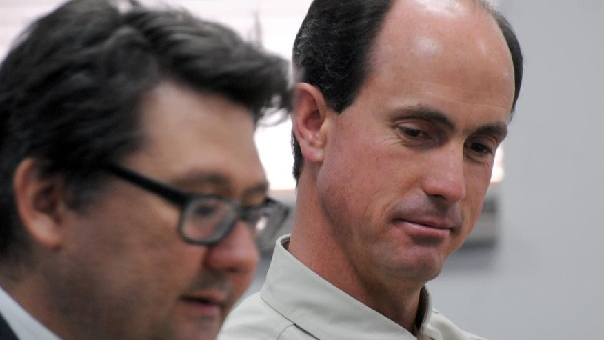 Seth Jeffs, right, the brother of Warren Jeffs, imprisoned leader of a polygamist sect, participates in a state water board meeting, Thursday, July 9, 2015, in Pierre, S.D. Jeffs and members of the United Order of South Dakota, a trust run by the Fundamentalist Church of Jesus Christ of Latter-Day Saints, are requesting additional water for their remote South Dakota compound.  (AP Photo/James Nord)