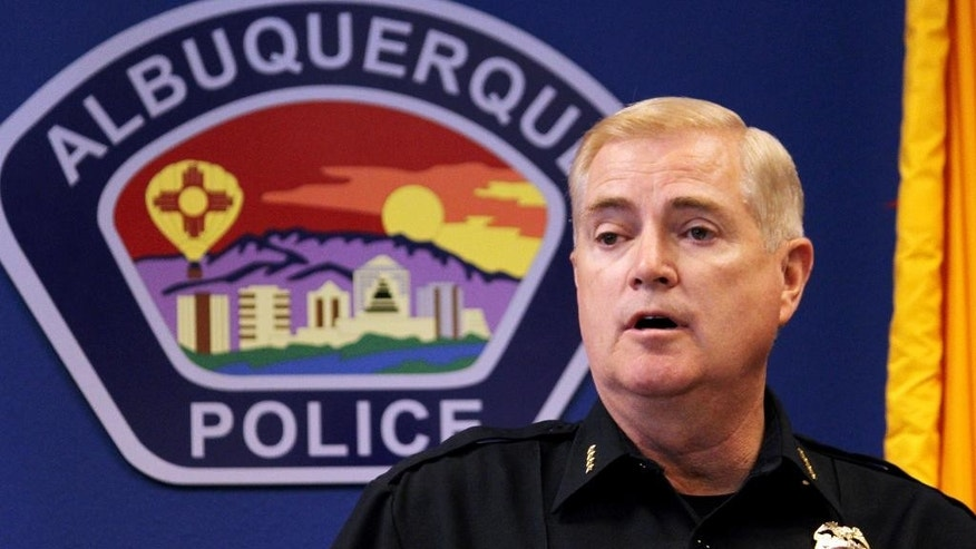 Albuquerque Police Chief Gorden Eden discusses the arrests of six teenagers who are accused in a deadly crime spree during a news conference in Albuquerque, N.M., Friday, July 10, 2015. Eden said a police task force put in hundreds of hours to identify the suspects in the June 26 shooting death of Steve Gerecke.  (AP Photo/Susan Montoya Bryan)