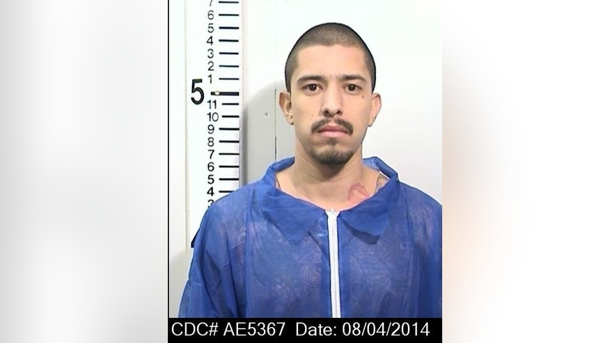 This August 8 2014 photo provided by the California Department of Corrections and Rehabilitation shows inmate Nicholas Anthony Rodriguez, who was killed in California State Prison, Solano, in Vacaville, Calif., this past May.  An autopsy report reveals that Rodriguez' body was cut apart and most of his major body organs removed, prompting an investigation of whether a riot by dozens of prisoners was used to cover up the homicide.(AP Photo/California Department of Corrections and Rehabilitation.)