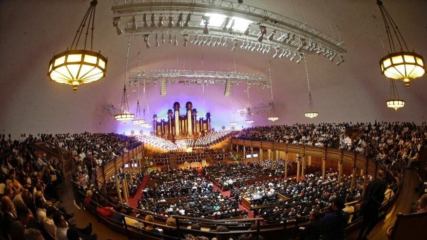 People attend a memorial service for Mormon leader Boyd K. Packer at the Tabernacle, on Temple Square Friday, July 10, 2015, in Salt Lake City. Packer's death on July 3 at the age of 90 from natural causes left the religion with two openings on a high-level governing body called the Quorum of the Twelve Apostles. (AP Photo/Rick Bowmer)