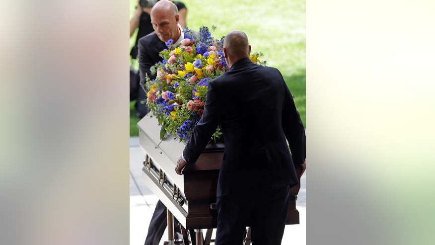 Pallbearers carry the casket of Mormon leader Boyd K. Packer during a memorial service at the Tabernacle, on Temple Square Friday, July 10, 2015, in Salt Lake City. Packer's death on July 3 at the age of 90 from natural causes left the religion with two openings on a high-level governing body called the Quorum of the Twelve Apostles. (AP Photo/Rick Bowmer)