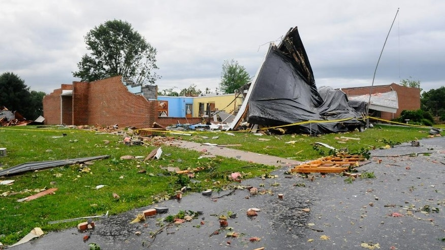 Debris is scattered around the Blue Mountain Seventh-Day Adventist Elementary School after a severe storm rolled through the area in Tilden Township, Pa. in Berks County on Thursday, July 9, 2015. (Jacqueline Dormer/The Republican-Herald via AP) MANDATORY CREDIT