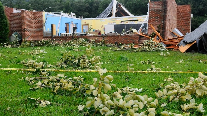 A classroom is exposed in the back of the Blue Mountain Seventh-Day Adventist Elementary School in Tilden Township, Pa., after a severe storm rolled through the area damaging the school building in Berks County on Thursday, July 9, 2015. (Jacqueline Dormer/The Republican-Herald via AP) MANDATORY CREDIT