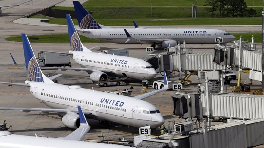 July 8, 2015: United Airlines planes are parked at their gates as another plane, top, taxis past them at George Bush Intercontinental Airport.