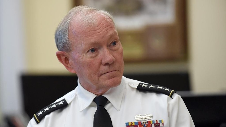 Joint Chiefs Chairman Gen. Martin Dempsey speaks during an interview with The Associated Press at the Pentagon.
