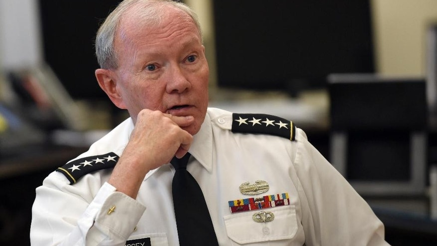 Joint Chiefs Chairman Gen. Martin Dempsey speaks during an interview with The Associated Press at the Pentagon in Washington, Wednesday, June 24, 2015. The man often called America's top military officer, the most powerful person in uniform, actually commands nothing. No tanks, no planes, no ships, no troops. His voice carries great weight, but he gives no combat orders. As chairman Dempsey is the public face of the military, but he is not in the formal chain of command linking the president to his commanders in the field. Dempsey, who is completing four years in the job, has said it reminds him of entering the Army as a lowly second lieutenant.   (AP Photo/Susan Walsh)