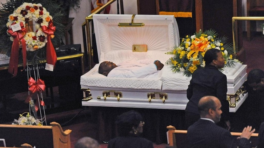 FILE - In this July 23, 2014, file photo, Eric Garner's body lies in a casket during his funeral at Bethel Baptist Church in the Brooklyn borough of New York. Nearly a year has passed since Garner had the encounter with New York City police that led to his death. Since then, his family has become national advocates for police reform and the department is changing how it relates to the public it serves. (AP Photo/New York Daily News, Julia Xanthos, Pool, File)