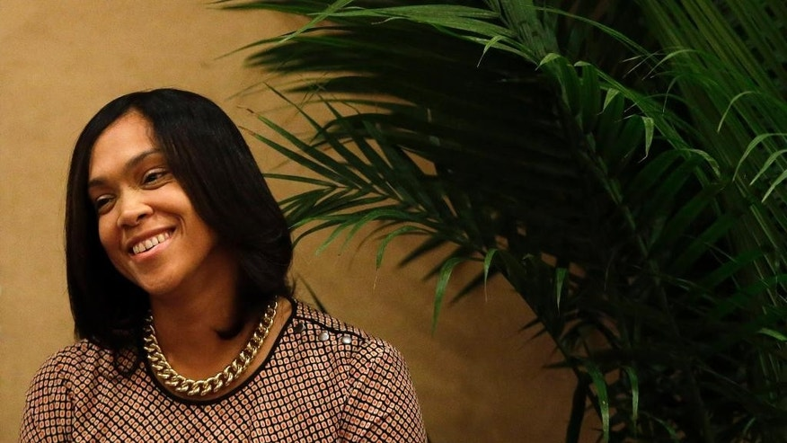 Baltimore State Attorney Marilyn Mosby smiles as she is introduced before delivering the keynote address during the Women in NAACP Empowerment Forum and Brunch, Sunday, July 12, 2015, in Philadelphia. The event was a part of the NAACP's 106th Annual National Convention, running through July 15. (AP Photo/Matt Slocum)