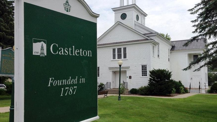 In this July 9, 2015 photo, a sign notes the school's founding in 1787 on the campus of Castleton State College in Castleton, Vt. The college seeks to change its name to Castleton University to reflect its growth in graduate programs and to attract more out-of-state and foreign students. (AP Photo/Lisa Rathke)