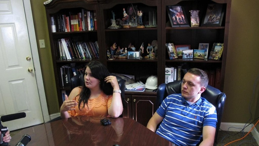 Ginger Smyth and her fiancé, Michael Culicerto sit for an interview in Pineville, W.V., on Tuesday, June 9, 2015. A team from West Virginia University was in Wyoming County collecting samples of the local dialect and gathering oral history. (AP Photo/Allen G. Breed)