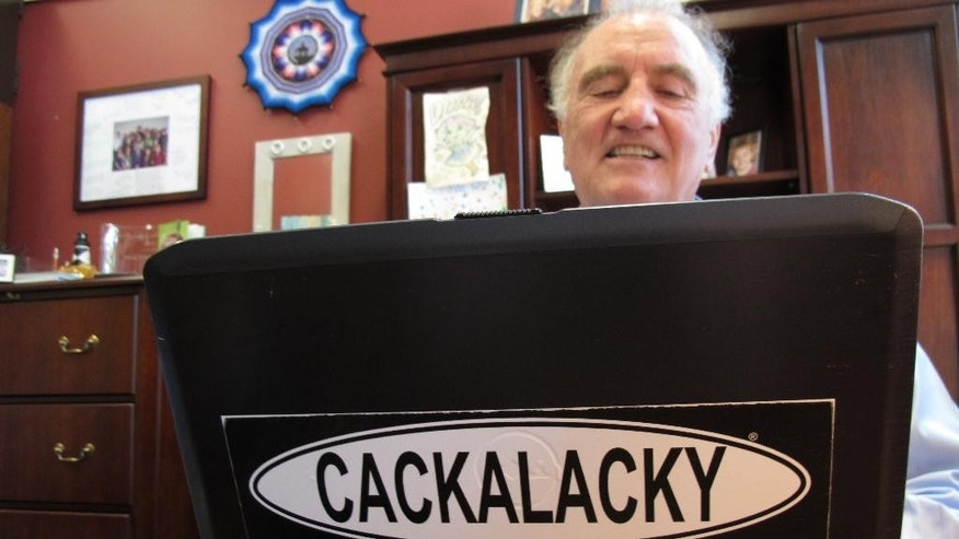 "North Carolina State University Linguistics Professor Walt Wolfram types in his office in Raleigh, N.C., on Tuesday, June 16, 2015. Wolfram says words like ""Cackalacky,"" a colloquial term for North Carolina, make regional dialects richer and more interesting. (AP Photo/Allen G. Breed)"