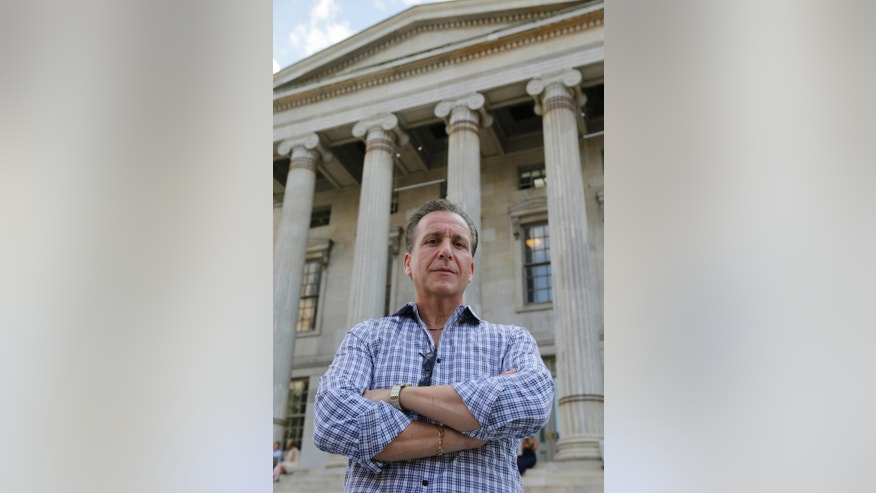 In this June 9, 2015 photo, Joe Ponzi, former chief of the Brooklyn District Attorney Investigators, poses in front of Brooklyn's Borough Hall in New York. In his 36 years on the job, Ponzi oversaw some of the borough's most famed cases, including the indictment of two sitting state supreme court judges. A famed polygraph expert, Ponzi is credited with gaining the confession of a conspirator who proved key in the prosecutions against the so-called Mafia Cops. (AP Photo/Kathy Willens)