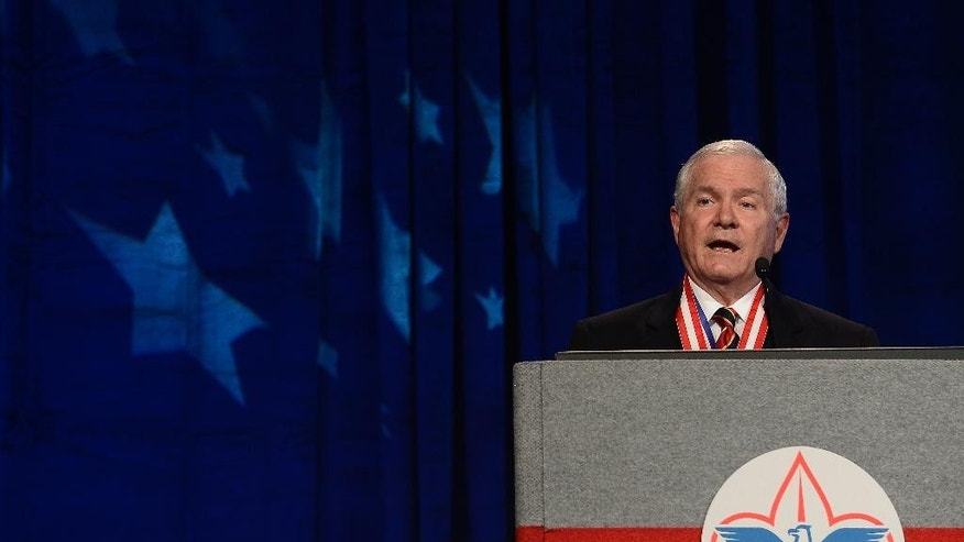 FILE - In this May 23, 2014, file photo, former Defense Secretary Robert Gates addresses the Boy Scouts of America's annual meeting in Nashville, Tenn., after being selected as the organization's new president. The executive committee of the Boy Scouts of America has unanimously approved a resolution that would end the organization's blanket ban on gay adult leaders and let individual scout units set their own policy on the long-divisive issue. The committee action follows an emphatic speech in May by the BSA's president, the former defense secretary declaring that the longstanding ban on participation by openly gay adults was no longer sustainable. (AP Photo/Mark Zaleski, File)