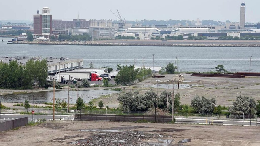 This July 13, 2015 photo, shows the area where a snow pile once gathered in Boston. Mayor Martin Walsh announced Tuesday, July 14, that Boston's once-massive pile of filthy snow has officially dwindled to nothing. (Jim Walker/Conventures, Inc. via AP)