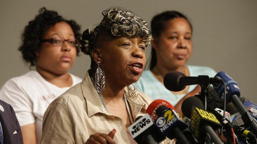 Eric Garner's mother Gwen Carr, center, is joined by his daughter Emerald Snipes, left, and wife Esaw Snipes, as she speaks during a news conference, Tuesday, July 14, 2015, in New York. The family of Garner, a black man who died after being placed in a white police officer's chokehold, discussed the $5.9 million settlement it reached with the city days before the anniversary of his death. (AP Photo/Mary Altaffer)