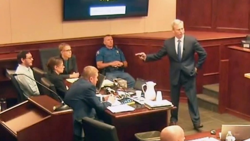 In this image taken from video, accused Colorado theater shooter James Holmes, left, listens to lead prosecutor George Brauchler give closing arguments during his trial, in Centennial, Colo., on Tuesday, July 14, 2015. (Colorado Judicial Department via AP, Pool)