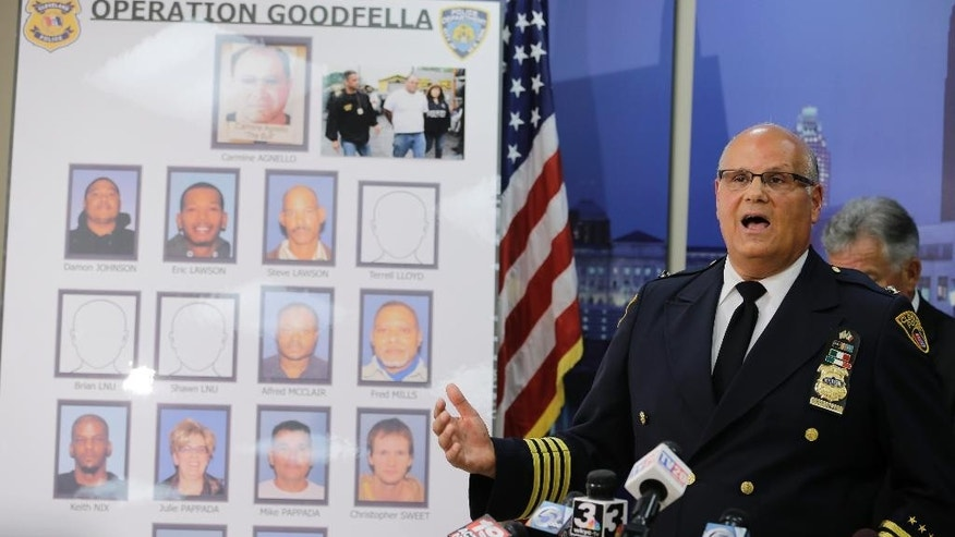 Cleveland Police Deputy Chief Ed Tomba answers questions about the arrest of Carmine Agnello at a news conference Wednesday, July 15, 2015, in Cleveland. Authorities say Agnello, a reputed member of New York's Gambino crime family, has been arrested in Cleveland after an 18-month investigation uncovered a $3 million scam involving stolen cars and scrap metal. (AP Photo/Tony Dejak)